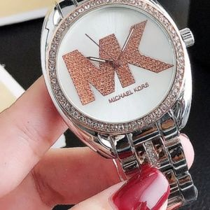 Michael Kors woman's rose gold watch